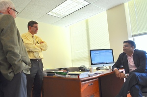 FROM L TO R: Prof. James Riedel, Prof. Gordon Bodnar  and Prof. Pravin Krishna talk in Prof. Krishna's office. Almost all the SAIS Economics professors will be teaching  in the MIEF degree program. (Kelley Kornell)