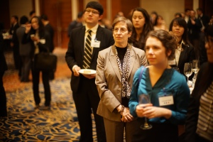 Beth Keck, and HNC students, listen to Director He's speech at Career Day.  (Zhang Wen)
