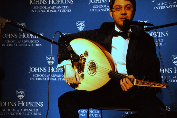 Ahmet Cinar plays the oud and sings a Turkish song during the talent portion of the pageant. (Sarah Rashid)