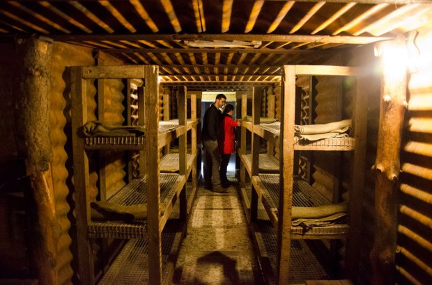 Daniel Flesch and Rebecca Ward (MA 15) check out the accommodations in a recreated German dugout at a museum covering the 1917 Battle of Passchendaele near Ypres.  (Photo: Benji Preminger)