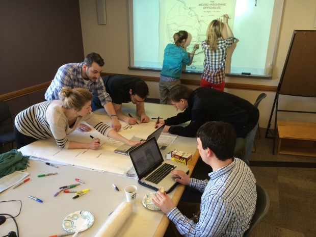 Several weeks prior to departure, students work to create the large canvas maps that are used during presentations on the ISR.  (Photo: Mike Youn)