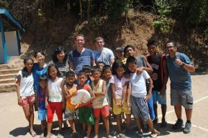 Five Hopkins-Nanjing Center students visited the Philippines to assist the residents of  Maricaban.