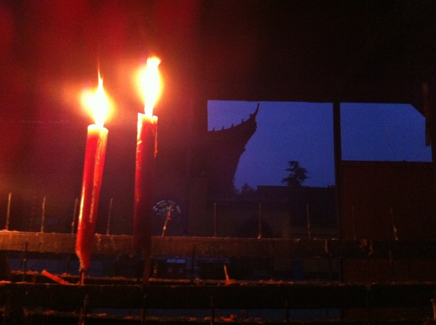 Prayer candles burning in the night.