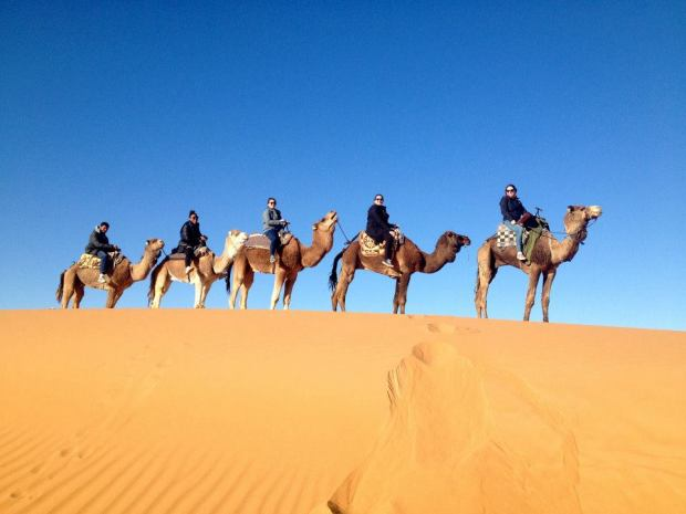 Riding camels in the Western Sahara. (Photo: Andrew Smedley)