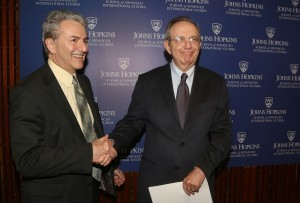 Director Plummer (left) and Finance Minister Padoan (right) shaking hands. (Source: Courtesy of SAIS Europe)