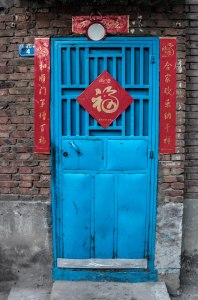 The banners around the door wish the family good luck and fortune in the new year.  The character in the middle is 福 (wealth). (all photos by Nooz Phlannel)