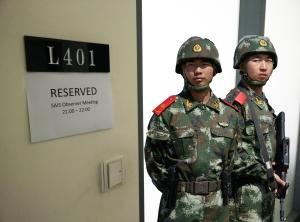 Internet Police prepare to make entry (Source: Theo Robie)