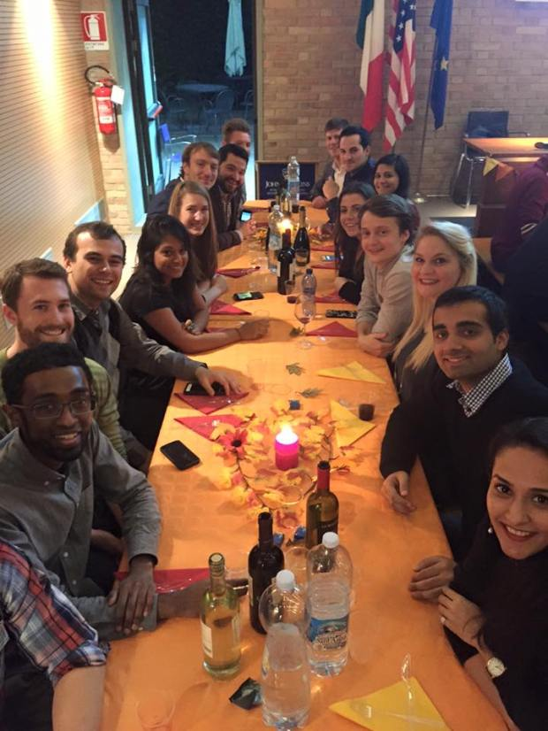 SAIS Europe students gather on Friday, Nov. 27 to celebrate Thanksgiving. The students did the best they could to make traditional dishes with the ingredients available in Bologna. Various dishes gave the event an international flavor. (Photo Courtesy: Fatima Nanavati)