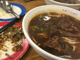 Enjoy a bowl of spicy beef noodle soup at Yongkang beef noodle house. Lines are common, but worth the wait.
